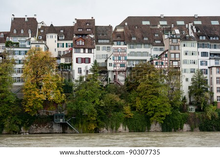 Waterfront houses along the Rhine River in Basel, Switzerland - stock photo