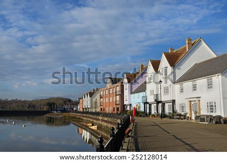 Waterfront houses overlooking a river in the UK - stock photo