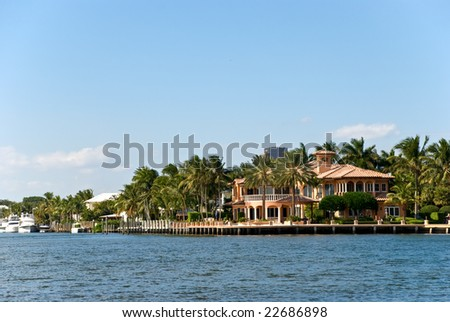 Waterfront mansion - stock photo