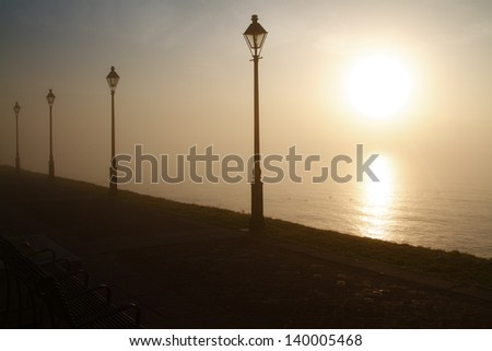 Waterfront Sidewalk in the Golden morning Dawn - stock photo