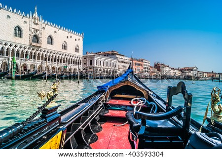 Waterfront view at cityscape of Venice from gondola in Adriatic sea. / Venice and gondola, Italy. / Selective focus. - stock photo