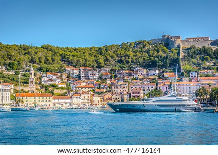 Waterfront view at famous touristic town Hvar on Adriatic sea, Croatia summertime, Europe. / Town Hvar summer cityscape. / Selective focus.