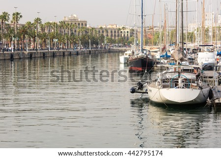 Waterfront with boardwalk and sailboats at Port Vell, the old marina of Barcelona, Spain