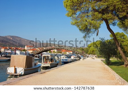 Waterfront with boats lined along the coast in Trogir, Croatia in a bright sunny summer day. - stock photo