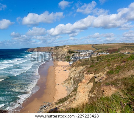 Watergate Bay Cornwall England UK Cornish north coast between Newquay and Padstow on a sunny blue sky day popular surfing beach - stock photo