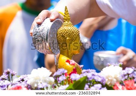 watering buddha in Songkran festival thailand - stock photo