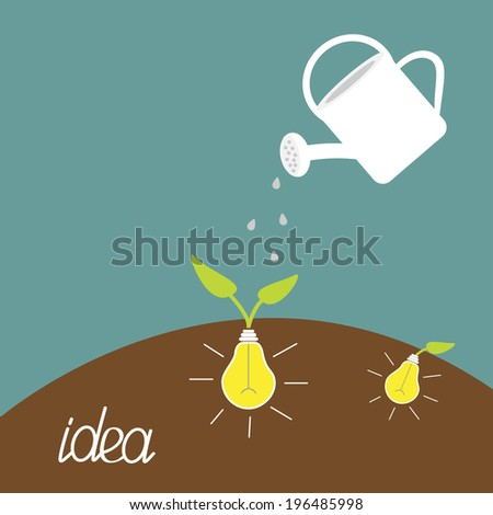 Watering can and lamp bulb plant. Growing idea concept.  - stock photo