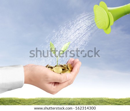 watering can and the gold coins  - stock photo