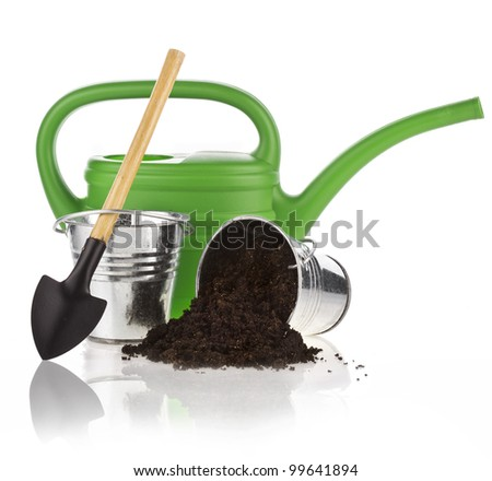 Watering can, bucket, spade, soil on white background - stock photo