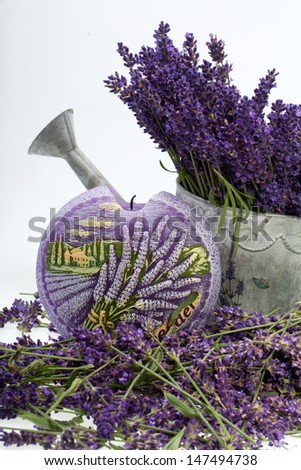 Watering Can, Candle and Lavender isolated on white