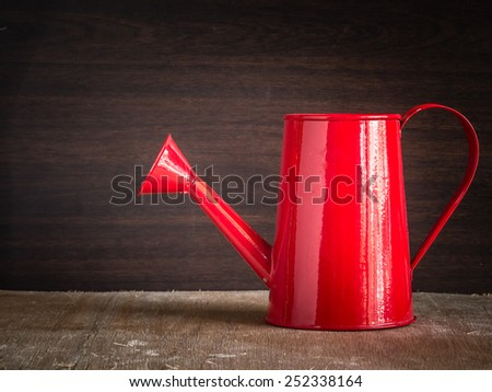 watering can old retro vintage style - stock photo