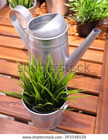 Watering Can or Watering Pot with Green Artificial Plants, Watering Can Used to Water Plants by Hand.