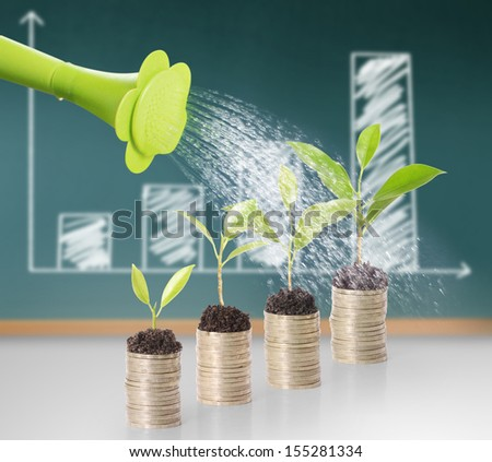 watering can pouring molten gold the gold coins  - stock photo