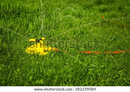 Watering grass rotation - stock photo