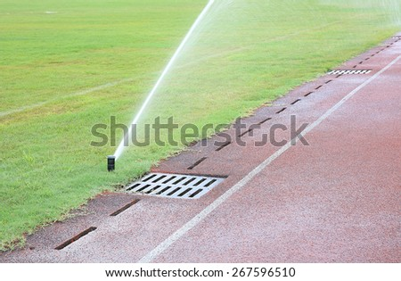 watering lawn - stock photo
