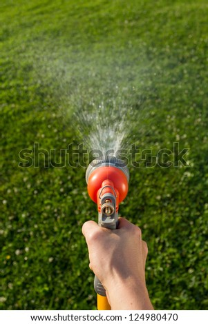 Watering the lawn - stock photo