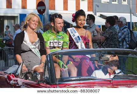 WATERINGEN, THE NETHERLANDS  - JULY 28: Mark Cavendish, sitting between two Tour Misses, celebrates winning the Tour de France 2011 green jersey on July 29, 2011 in Wateringen, The Netherlands.