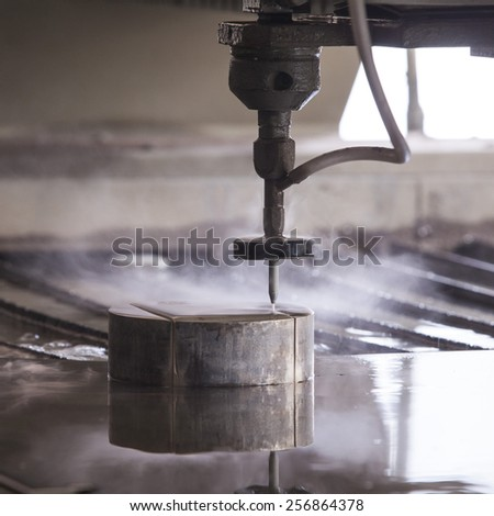 Waterjet metal cutter - stock photo