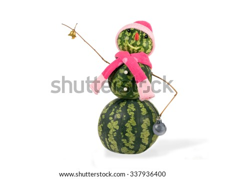 Watermelon christmas snowman with golden bell and Christmas ball in pink hat and scarf isolated. Holiday concept for New Years./Snowman made from watermelon with bell and Christmas ball. isolated.  - stock photo