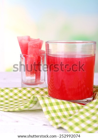 Watermelon cocktail in glass on table on natural background - stock photo