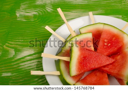 Watermelon cut in a way that resembles ice lollies, a kid dessert - stock photo