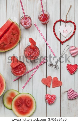 Watermelon drink in glasses with slices of watermelon in heart shape. Preparation for the Valentine's day