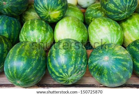 watermelon on fruit stand