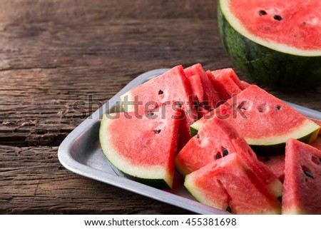 watermelon on wooden background,fresh sliced watermelon on the wooden table