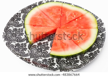 Watermelon slices on a plate, one slice missing