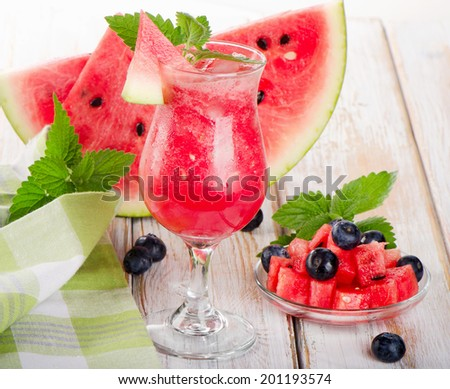 Watermelon smoothie on a wooden table. Selective focus - stock photo