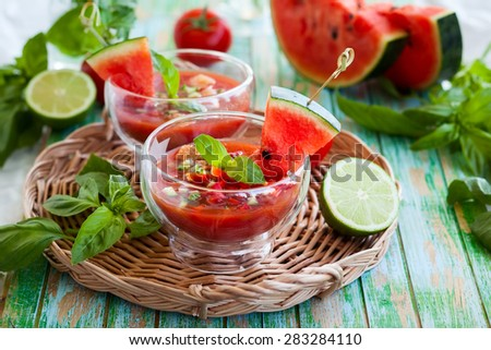 Watermelon tomato gazpacho in  glass bowls - stock photo