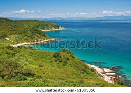 waterscape, emerald forest and marine blue combines the thin strip of beach