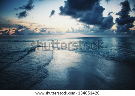Waterscape on Maldives in dusk - stock photo