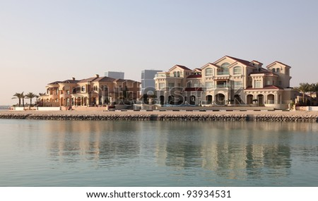 Waterside buildings at The Pearl in Doha, Qatar, Middle East - stock photo