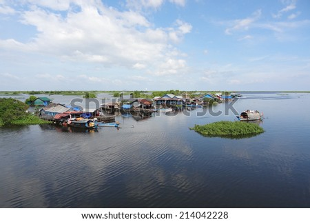 waterside scenery with rural houses and boats at the Tonle Sap, a river in Cambodia - stock photo