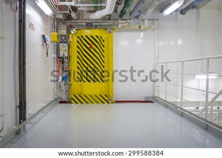 Watertight door on a ship - stock photo