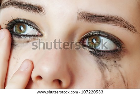 watery eye - sensitive eye of young girl - crying eye