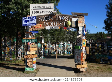 WATSON LAKE, YUKON, CANADA - AUGUST 2, 2014: The Sign Post Forest, the most popular attraction in Watson Lake.