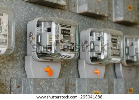 Watt hour Electric meter measurement tool at apartment. - stock photo