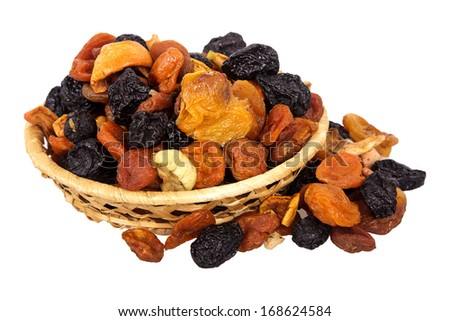 Wattled basket with dried fruits it is isolated on a white background