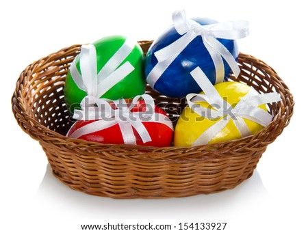 Wattled basket with the Easter eggs, isolated on white