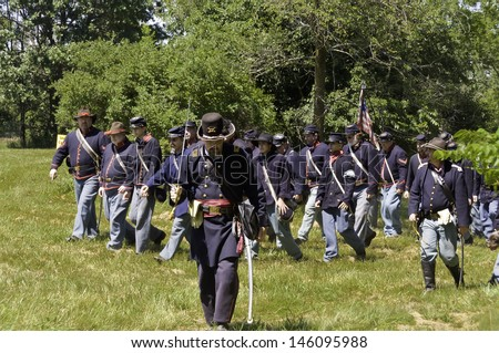 WAUCONDA, ILLINOIS/USA - JULY 13: American Civil War (1861-1865) reenactment on July 13, 2013, in Wauconda, Illinois. A Union officer leads his troops  toward a mock battle against Confederate forces.