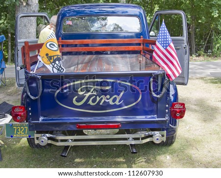 WAUPACA, WI - AUGUST 25:  Back of 1954 Ford F100 Truck at the 10th Annual Waupaca Rod & Classic Car Club Car Show on August 25, 2012 in Waupaca, Wisconsin. - stock photo