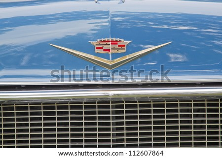 WAUPACA, WI - AUGUST 25: Emblem close up of a 1957 Cadillac Fleetwood car at the 10th Annual Waupaca Rod & Classic Car Club Car Show on August 25, 2012 in Waupaca, Wisconsin. - stock photo