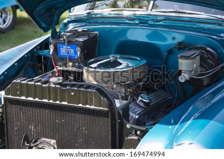WAUPACA, WI - AUGUST 24, 2013:  Engine of 1952 Blue Chevy Delivery Sedan at Waupaca Rod and Classic Annual Car Show August 24, 2013 in Waupaca, Wisconsin.