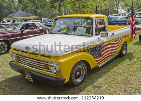 WAUPACA, WI - AUGUST 25: 1961 Ford Unibody F100 Truck at the 10th Annual Waupaca Rod & Classic Car Club Car Show on August 25, 2012 in Waupaca, Wisconsin. - stock photo