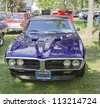 WAUPACA, WI - AUGUST 25: Front of 1967 Purple Pontiac Firebird car at the 10th Annual Waupaca Rod & Classic Car Club Car Show on August 25, 2012 in Waupaca, Wisconsin. - stock photo