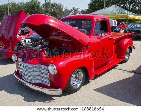 WAUPACA, WI - AUGUST 24:  Side view of a Red Chevy Antique PickUp Truck at Waupaca Rod and Classic Annual Car Show August 24, 2013 in Waupaca, Wisconsin.