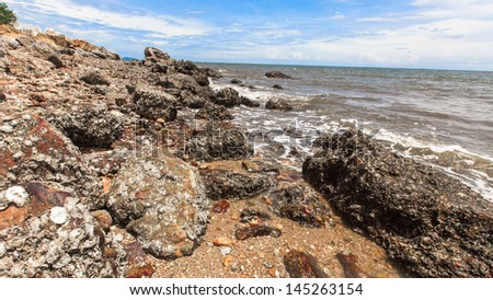 wave and rock in beach of gulf of thailand
