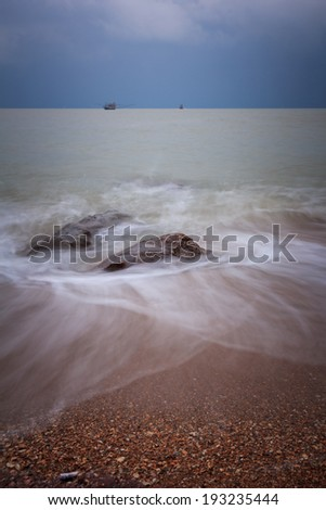 wave and the rock with sunrise sky at Pattayabeach, Thailand. - stock photo